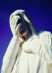 Weeping Jesus statue close up
