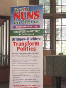 A vertical banner reading: The Nuns on the Bus, Bridge the Divides:  Transform Politics