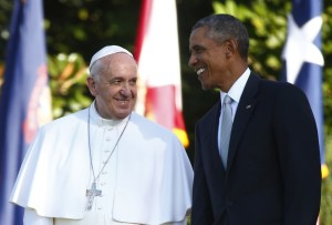 A picture of a smiling President Obama welcoming Pope Francis, also smiling, to the Whitehouse