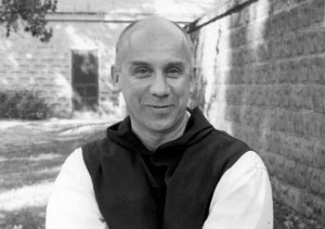 Thomas Merton standing outside
