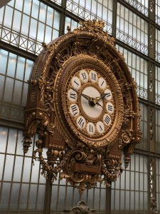 Large, ornate gold and white clock in Musee d'Orsay Paris France