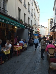 photo of small street in Paris lined with small cafes