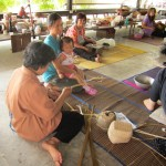 Photo of Thai women weaving baskets at the Bamboo Basketry Handicraft Centre, Chonburi Thaniland