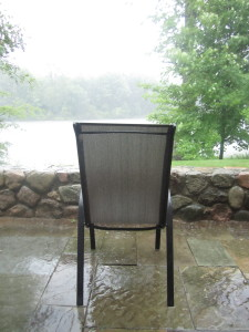 Chair in rain on patio