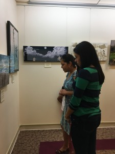 a mother and daughter viewing an art exhibit