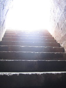 Photo of diffuse bright light at the top of stone staircase